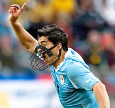 Luis Suarez of Uruguay celebrates  after scoring the opening goal against South Korea